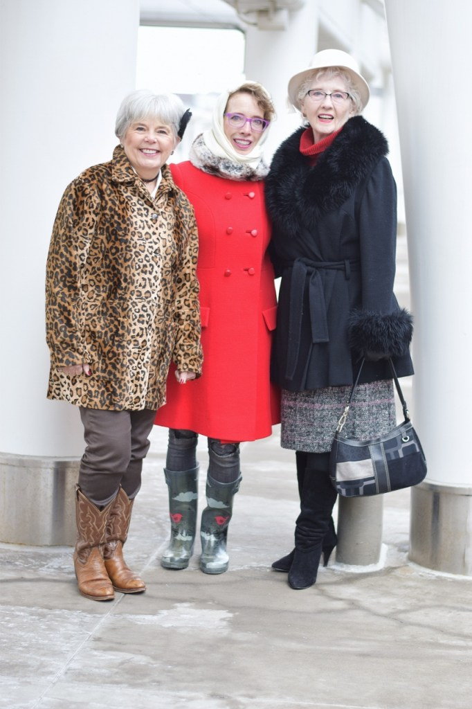 3 generations of women wearing a retro piece of clothing
