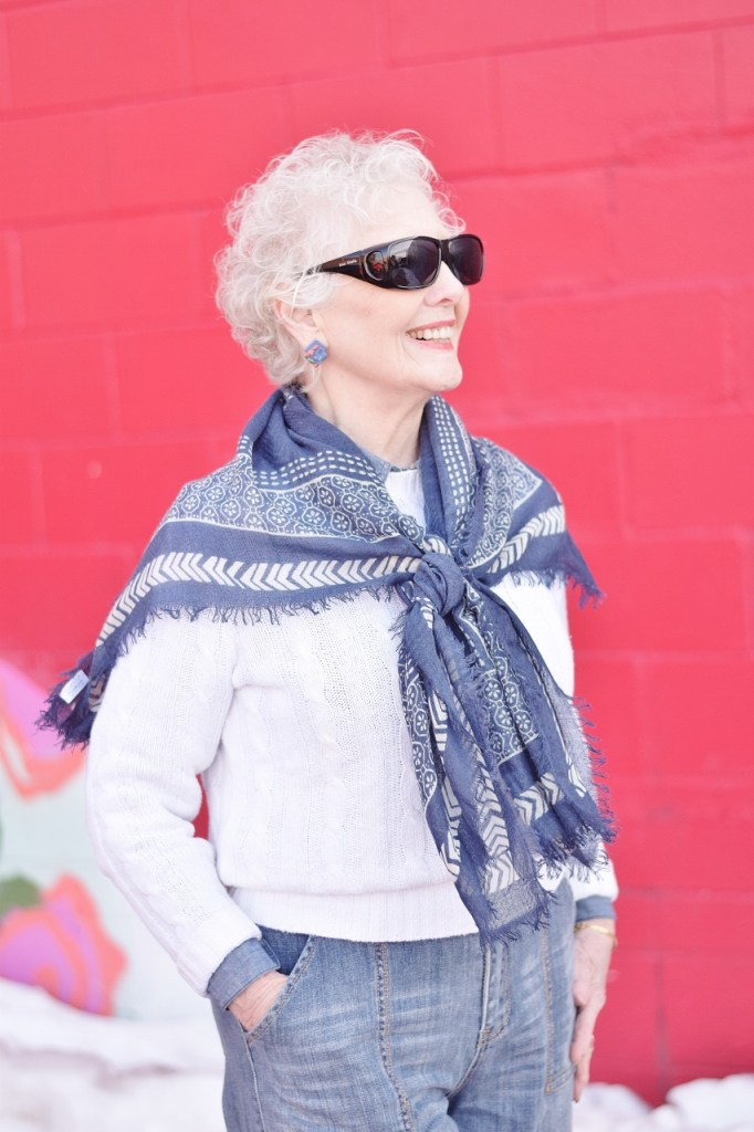 RockFlowerPaper and woman over 80 wearing scarf