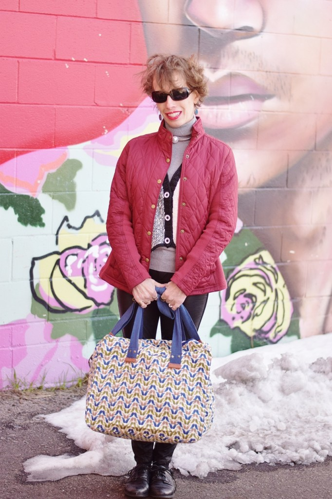 RockFlowerPaper and woman over 50 holding an overnight bag