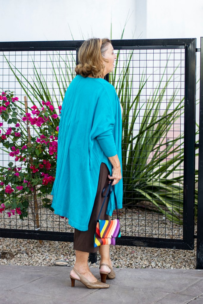 Wide leg pants with a cardigan that has slits