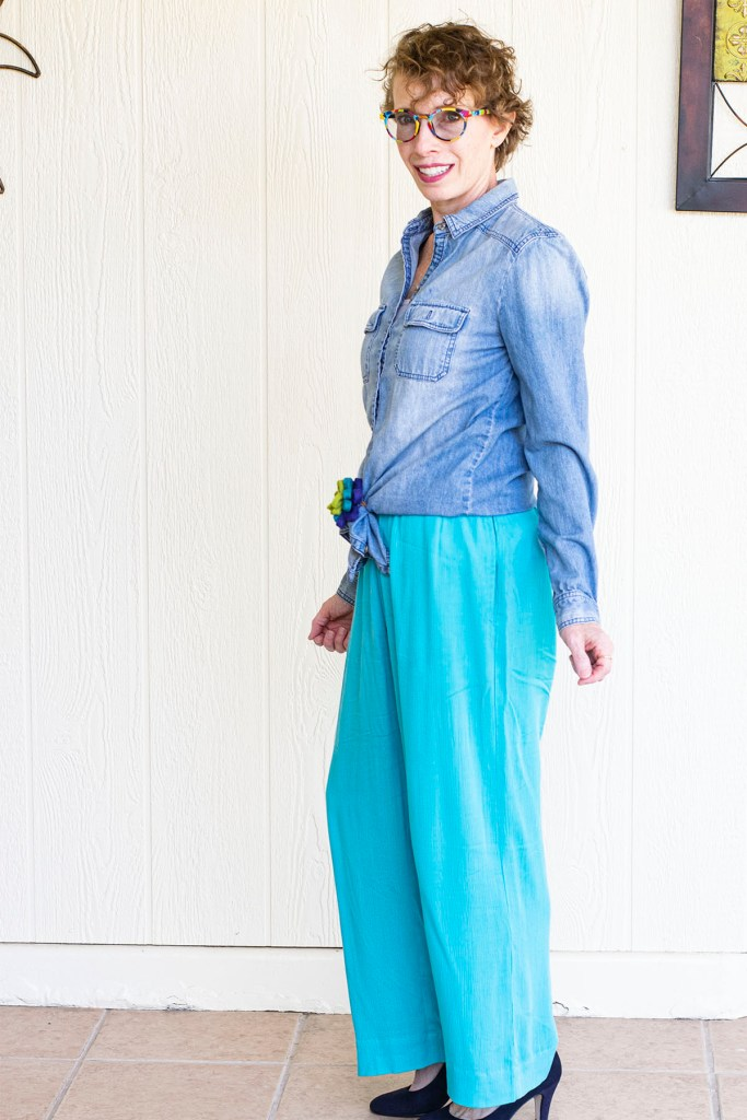 Side view of tied waist chambray top