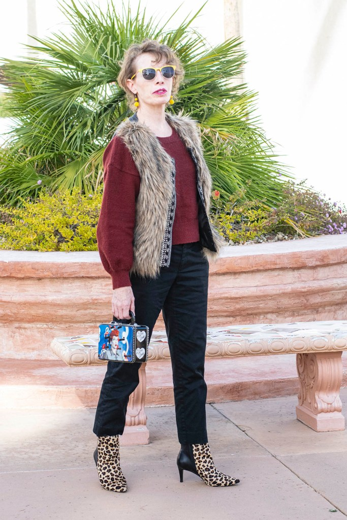 Adding glam to a red top and black pants outfit