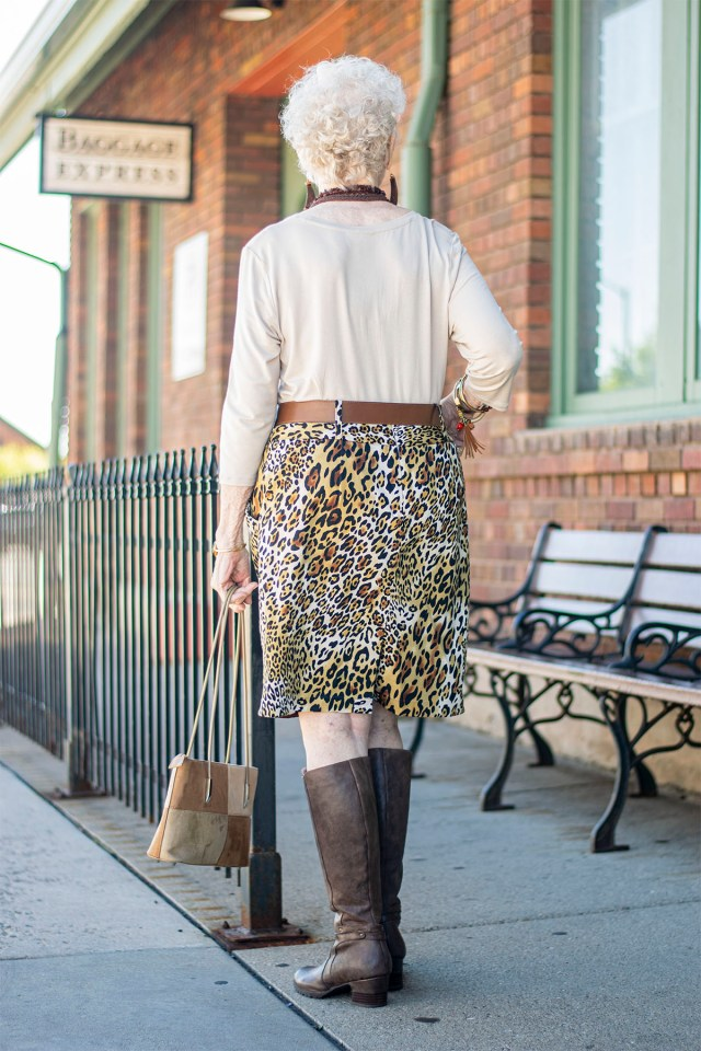 Knee high boots for fall with a leopard skirt