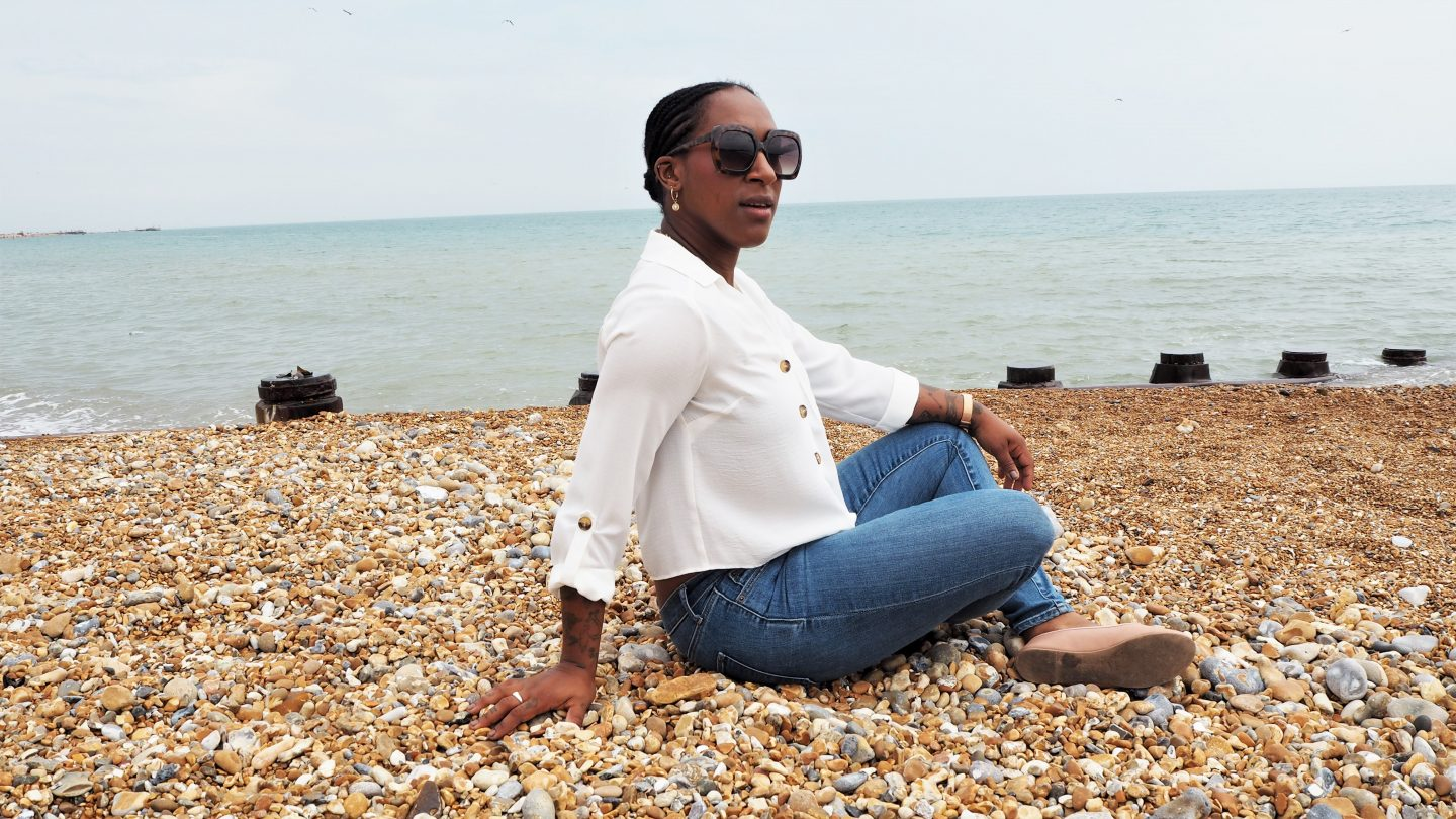 Beach photography with gold jewellery, the perfect skinny fit jeans. Whilst talking about careers and jobs