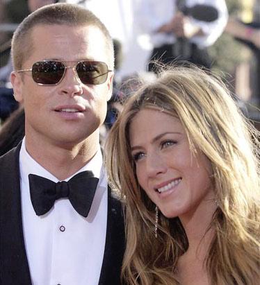 Jennifer Aniston and Brad Pitt way back when they were still together. LOL!