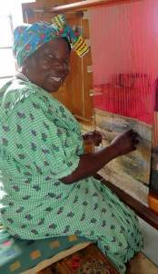 Regina, Mapusha Weaver with a work in progress tapestry on the loom