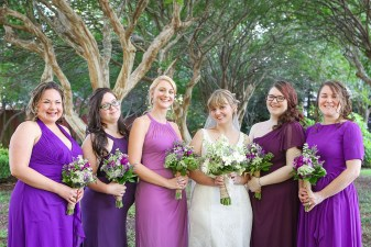 bride and purple maids