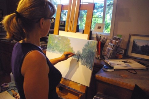 Judy working on the beginning stages of a mid sized painting.