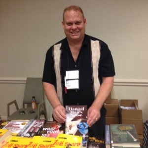 Don Longmuir, co-owner of Scene of the Crime books at the Bouchercon booksellers room.