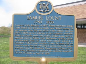 The plaque dedicated to Samuel Lount, located outside the Holland Landing Community Centre.