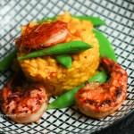 Saffron Risotto gluten free with Miso glazed Tiger Prawns and sugar peas