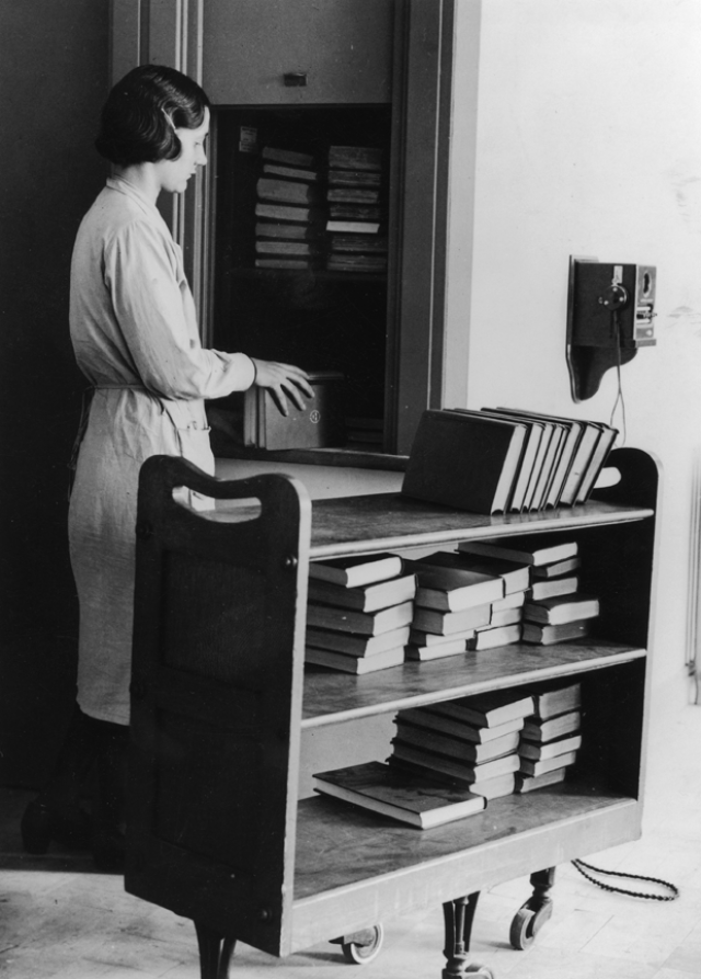 4. A librarian in the (at the time) new National Central Library places books into a dumbwaiter to transport them to another floor