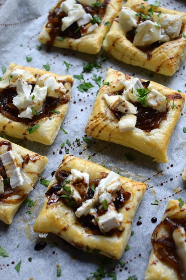 caramelized oinion tarts on a baking tray