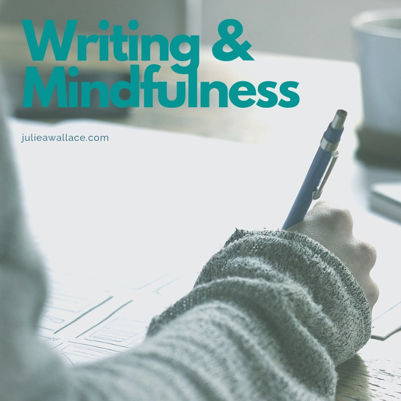 """A female hand holding a pen and writing. The words """"writing and mindfulness."""""""