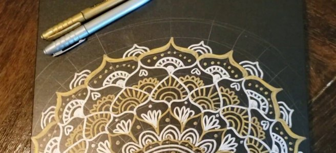 metallic gold and silver mandala on black paper