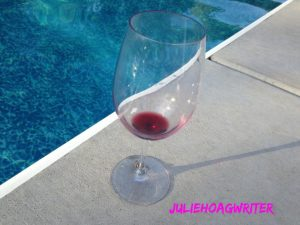 empty-wine-glass-by-pool-with-my-logo