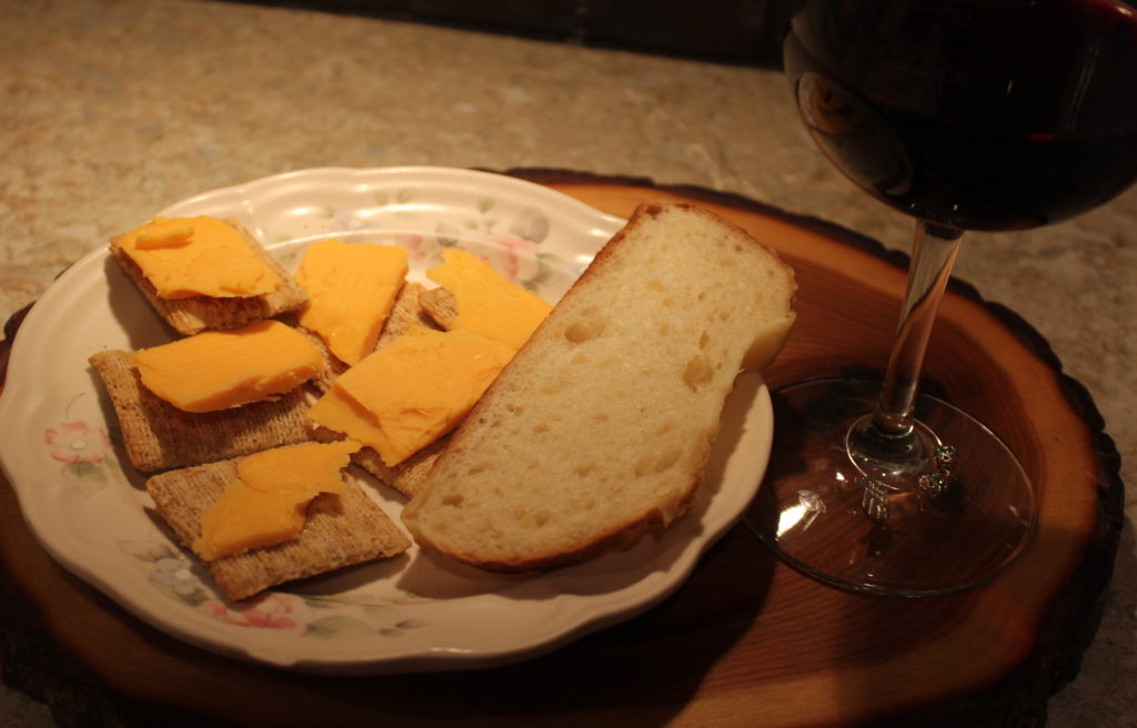 Aged cheddar cheese, crackers, Asiago Cheese bread, red wine