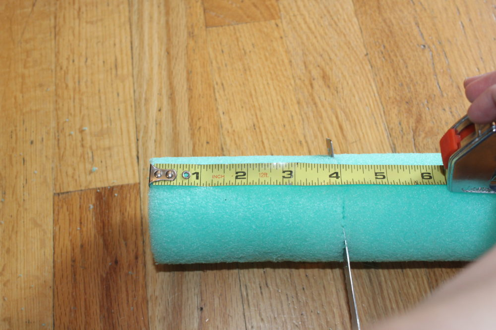 Cut the noodle in four inch sections only using the intact portions to make the DIY Pool Noodle Float ring.