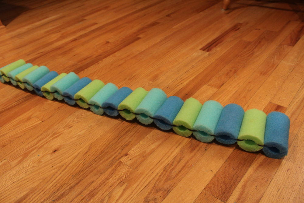 DIY Pool Noodle Float Ring, Or leave as a strip noodle raft if desired.