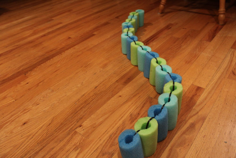 DIY Pool Noodle Float ring using pool noodles pieces. Connect the ends to make a ring or keep it straight to make a float strip.