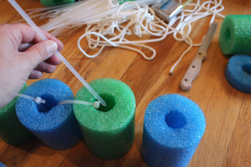 DIY Pool Noodle Float Raft. Feed the zip tie down through one noodle and up through the next.