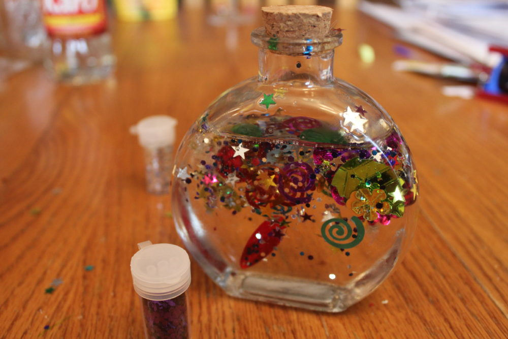 Spangles suspended in the jar.