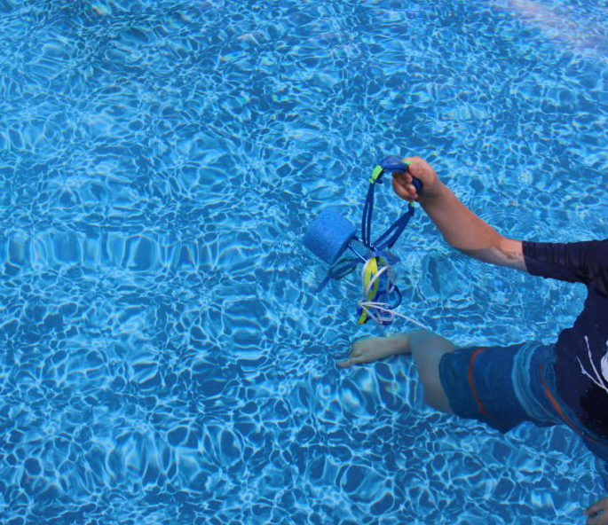 Kids can easily grab Pool Noodle Goggle float for easy access to goggles