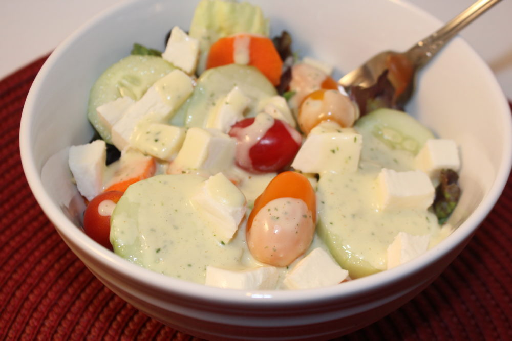 Tangy Homemade Cilantro Lime Salad Dressing on a salad. salad dressing recipe.