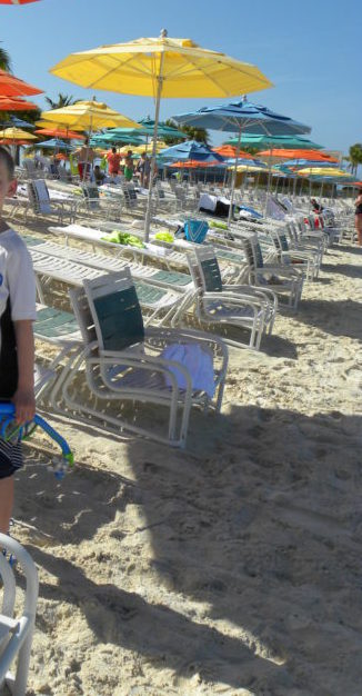 Beach chairs and umbrellas on Castaway Cay