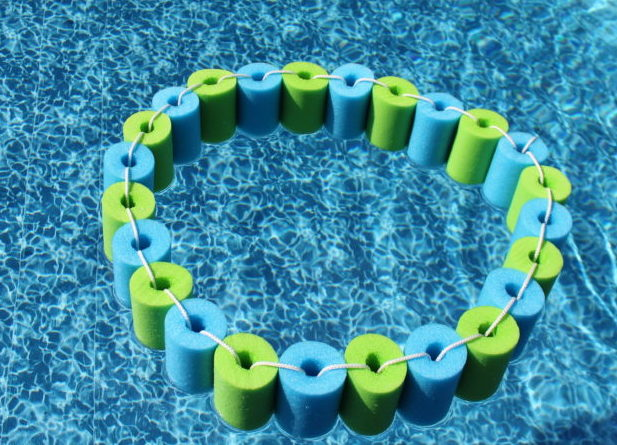DIY Pool Noodle Float in the pool in a ring shape.