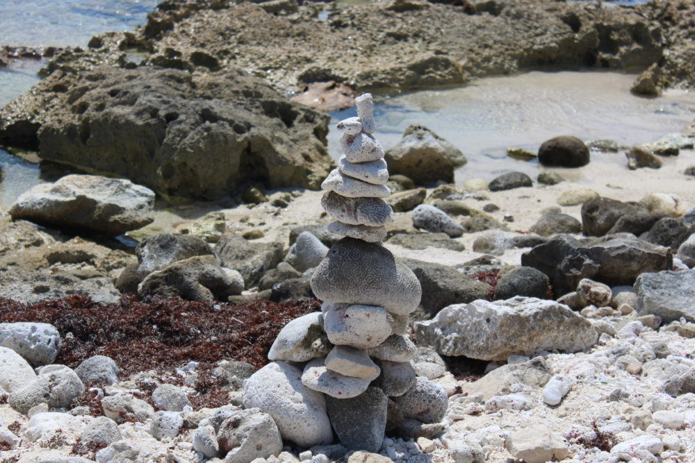 Rock sculpture on the beach at large all-inclusive resort.