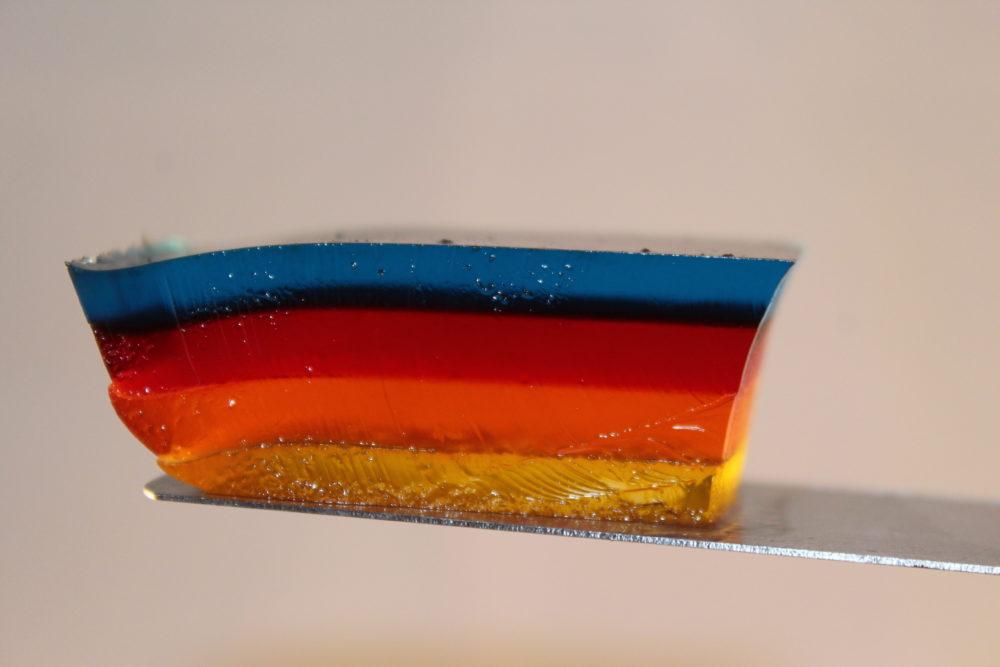 Slice of Multi Layered Jello on a spatula