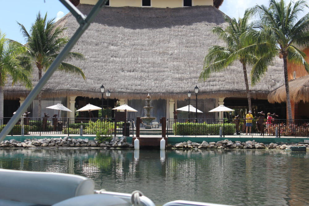 View of lobby from pontoon boat ride at large all-inclusive resort.