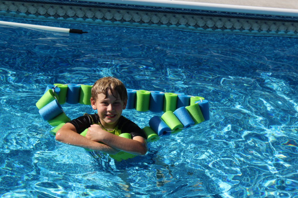 Hug the tail to float upright using the DIY pool noodle fish with headrest-DIY Pool Noodle Fish Float With Headrest-pool noodle ideas-swimming pools-inground pool-noodle crafts-pool noodles-pool ideas-pool toys-pool toys for kids-pool floats-pool floats for adults-swimming pools-swimming pool ideas-swimming pool backyard-pool play-pool fun for kids-pool fun ideas-swim floats kids-swim floats summer. @juliehoagwriter.com