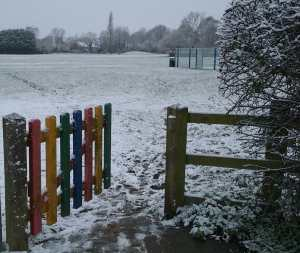 photo of a colourful open gate into a playing field lightly covered in snow, as an image of how counselling can help you find your way