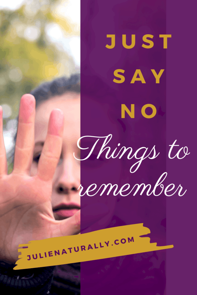 closeup of woman's face with hand in front of it to say no