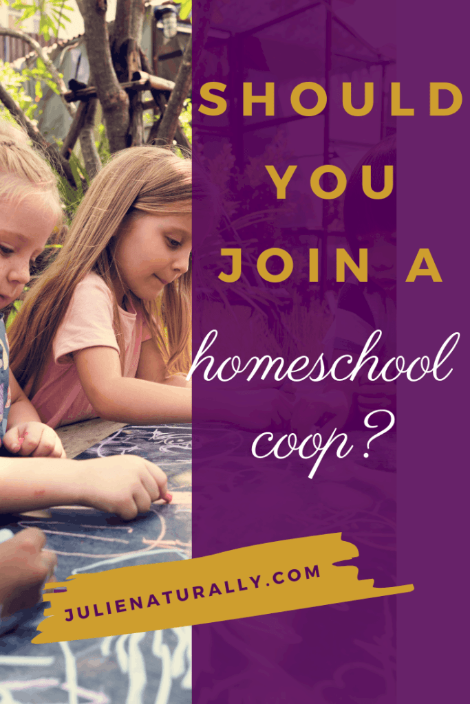 kids sitting at a blackboard table drawing with chalk at a homeschool coop