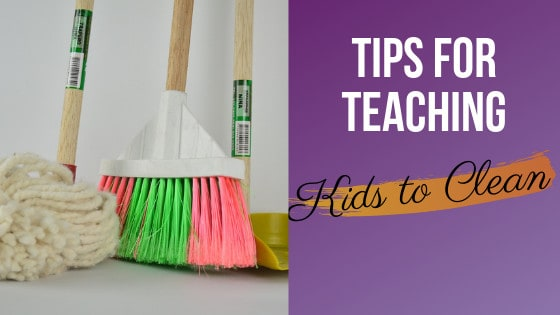 pink and green broom with a yellow push broom