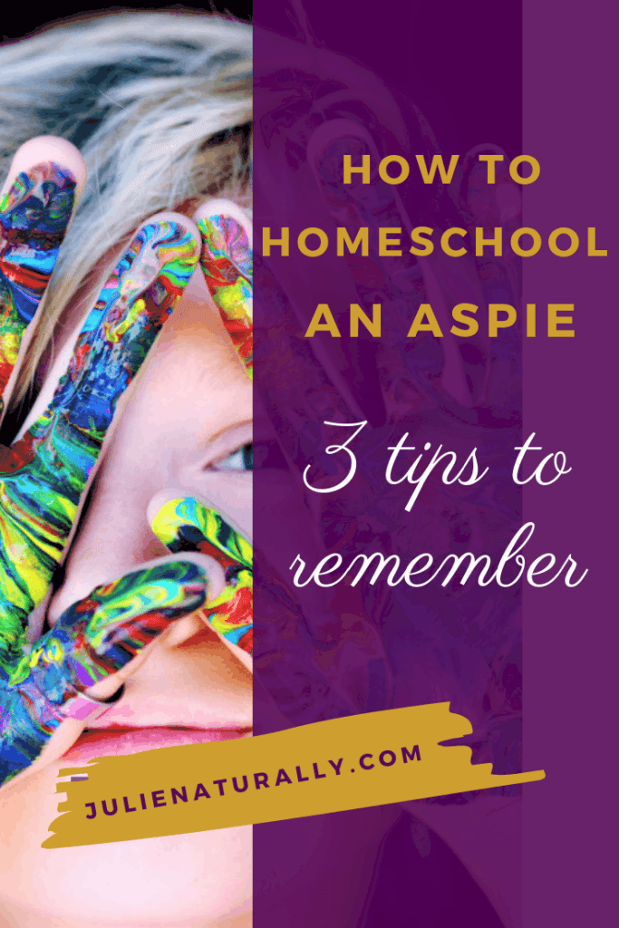 Homeschooling a child with Asperger's whose hands are covered in rainbow paint