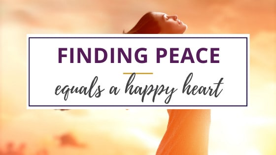 woman finding peace and throwing up her arms in happiness