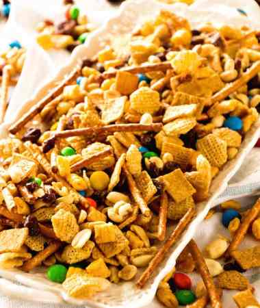 Snack Mix ~ This Snack Mix is like CRACK! So Addictive and Delicious! Full of Cereal, Pretzels, Peanuts, M&Ms and Raisins! Perfect for Christmas and Holiday Parties!