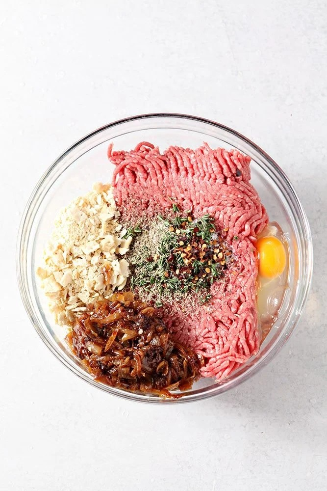 French Onion Meatloaf ingredients together in a glass bowl, ready to be mixed together to make the meatloaf