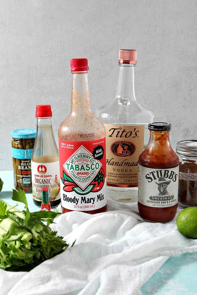 Bloody Mary Ingredients sit on a turquoise background