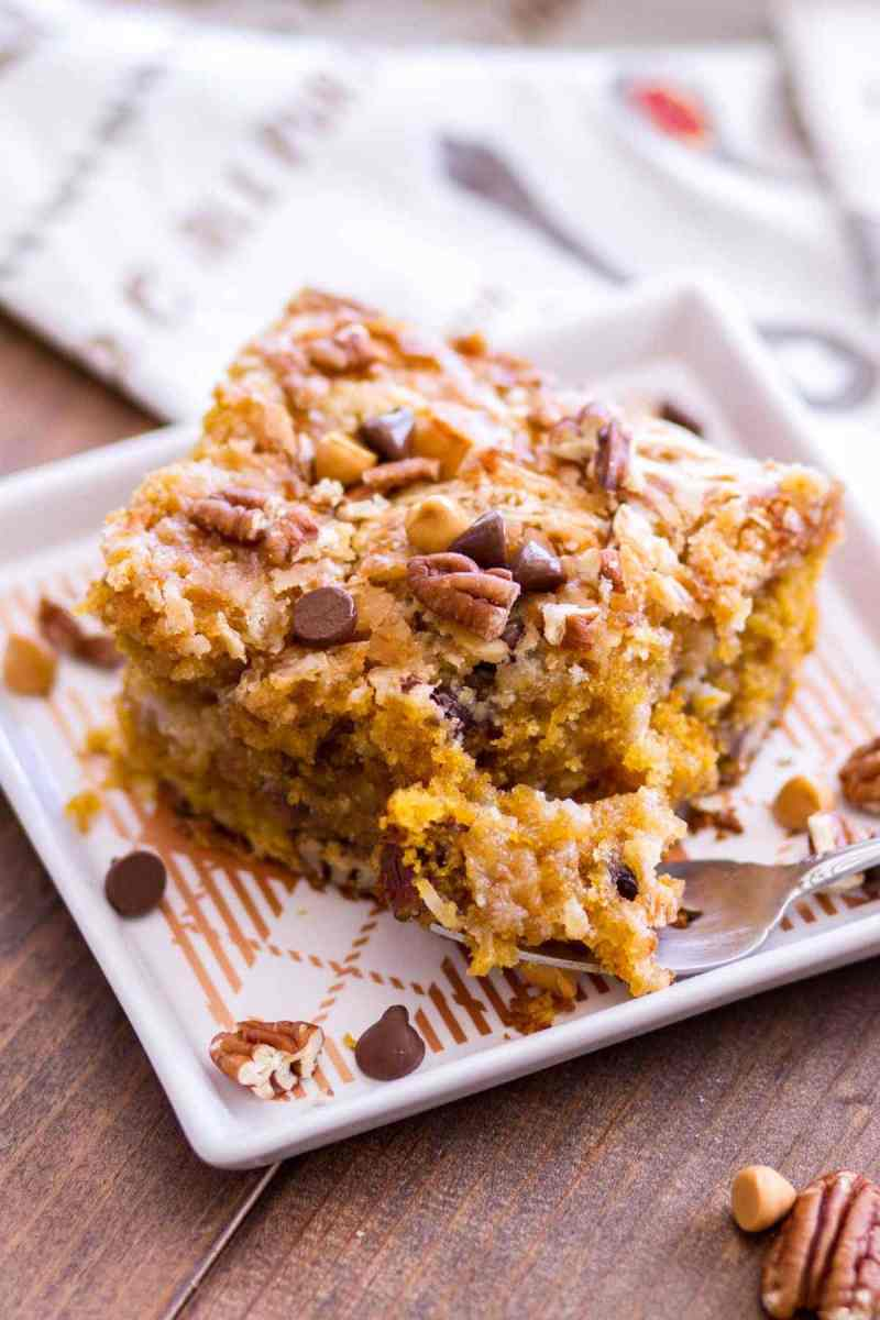 A slice of Pumpkin Earthquake Cake with a forkful serving ready to eat!