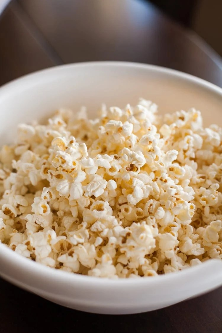 Homemade popcorn in white bowl