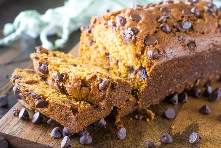 Pumpkin Bread with chocolate chips on wood cutting board
