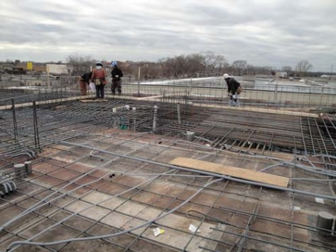 this area with the placement of rebar is directly to the left when looking west to the image below which is another area to filled with rebar and concrete to support the pullback of the building on this side.