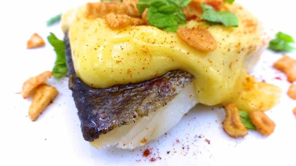 This is a classic Spanish salt cod recipe with a thick garlic, olive oil and chili sauce: also known as bacalao al pil pil!