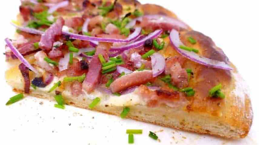 Yummy crunchy Flammkuchen, a French bacon and fresh cheese pizza from the Alsace region! Made with a very easy pizza dough...