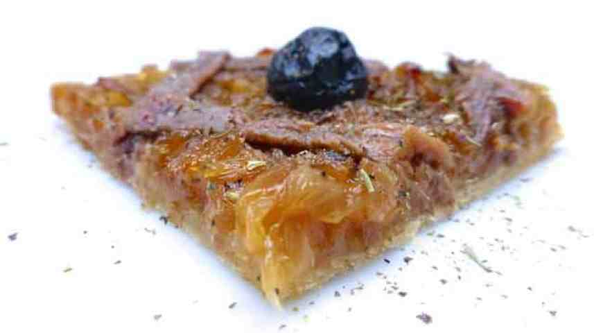 French pissaladiere, a caramelized onion pizza with black olives and salted anchovies from the mediterranean city of Nice!